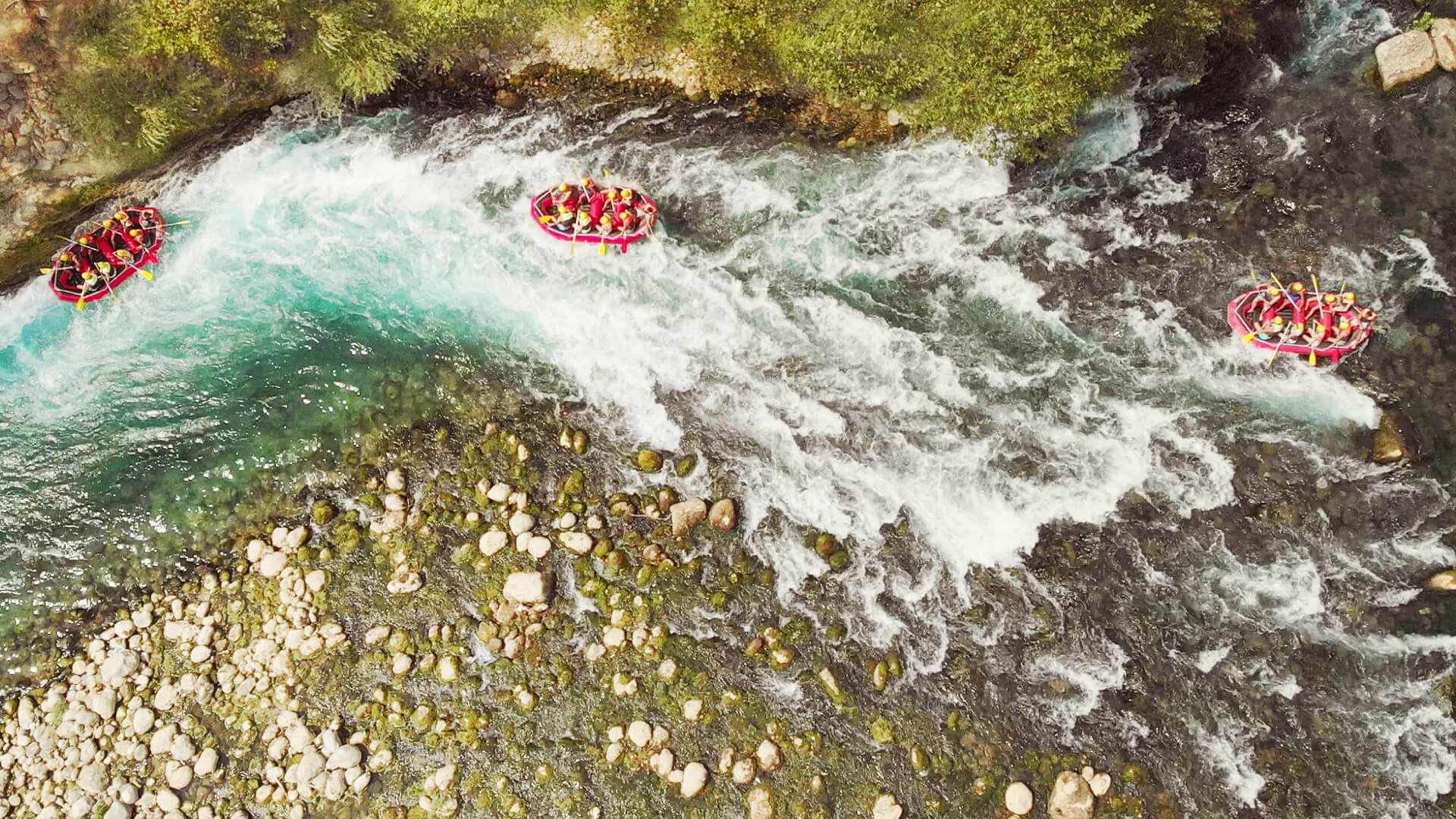 Whitewater rafters travel downstream