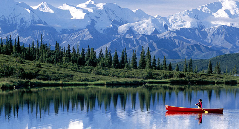Canoeing on a lake in the mountains- Suspend your GCI TV for up to 6 months!